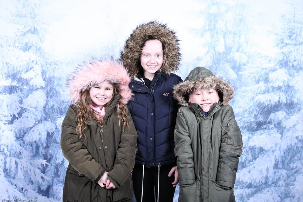 3 girls with hoods up on a winter picture