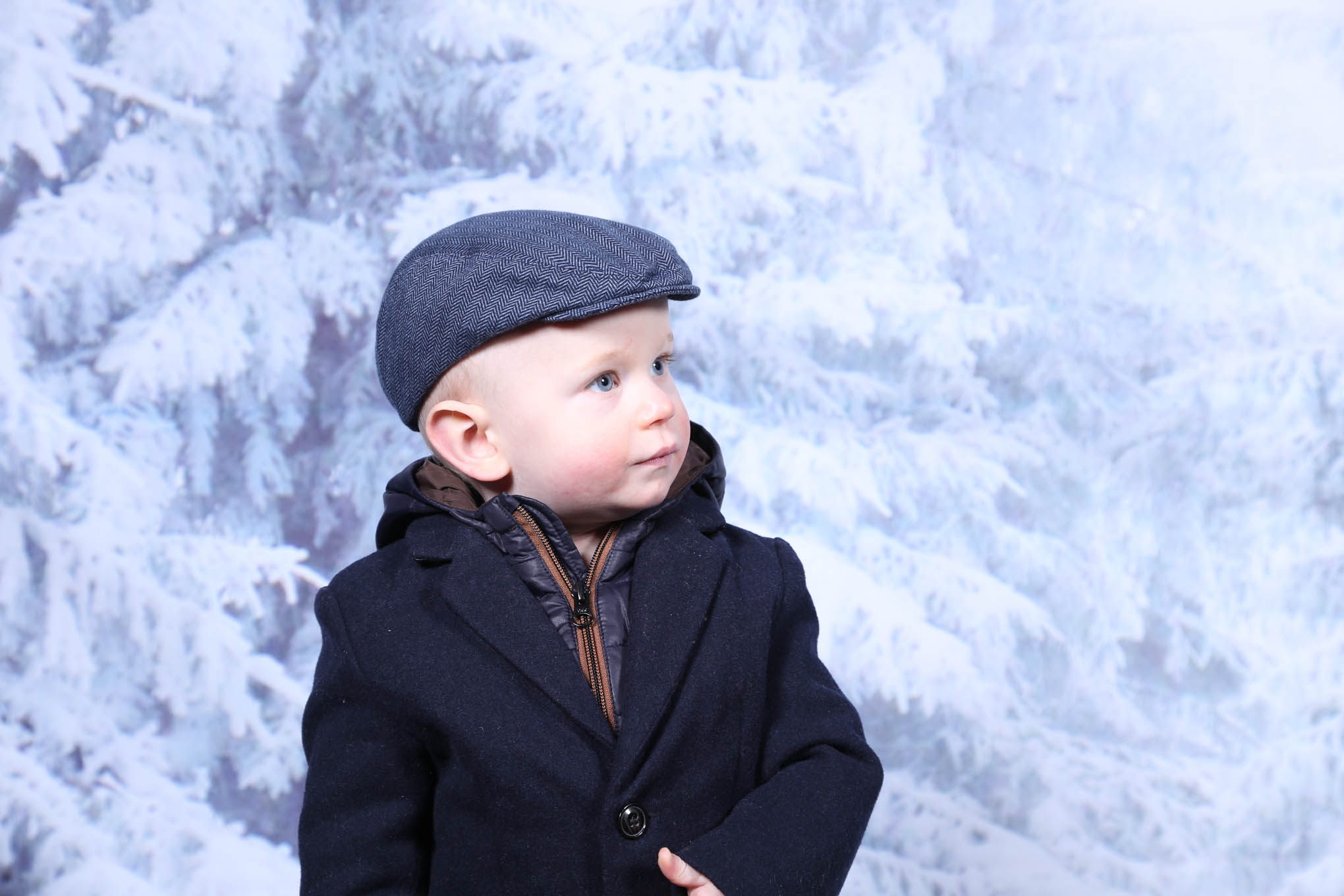 Child with flat cap on
